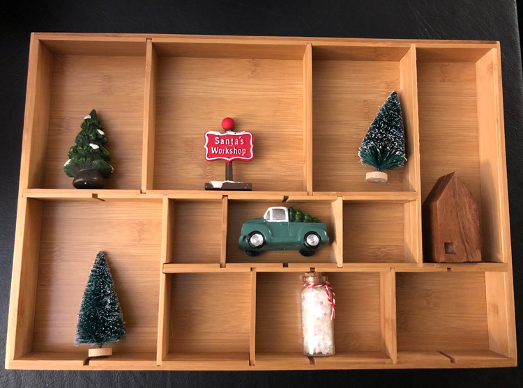 I love how a simple drawer organizer can be turned into a shadow or curio box for displaying Christmas and holiday miniature figurines.