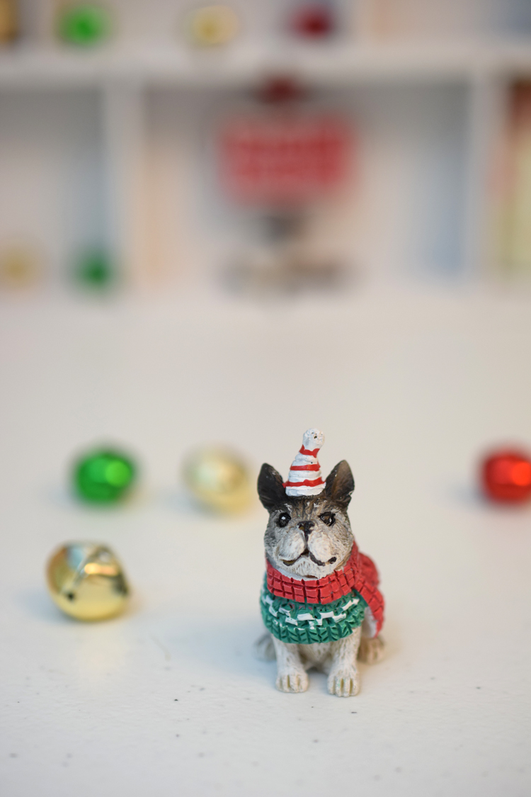 I love this adorable puppy miniature figurine. He'd be perfect in a curio or shadow box or in a Christmas village.