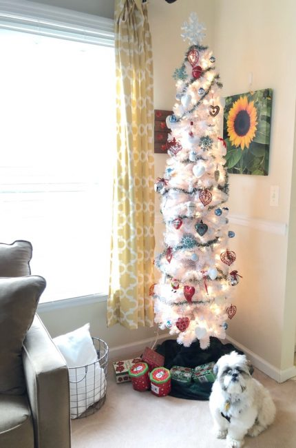 white christmas tree with a white Shih Tau puppy