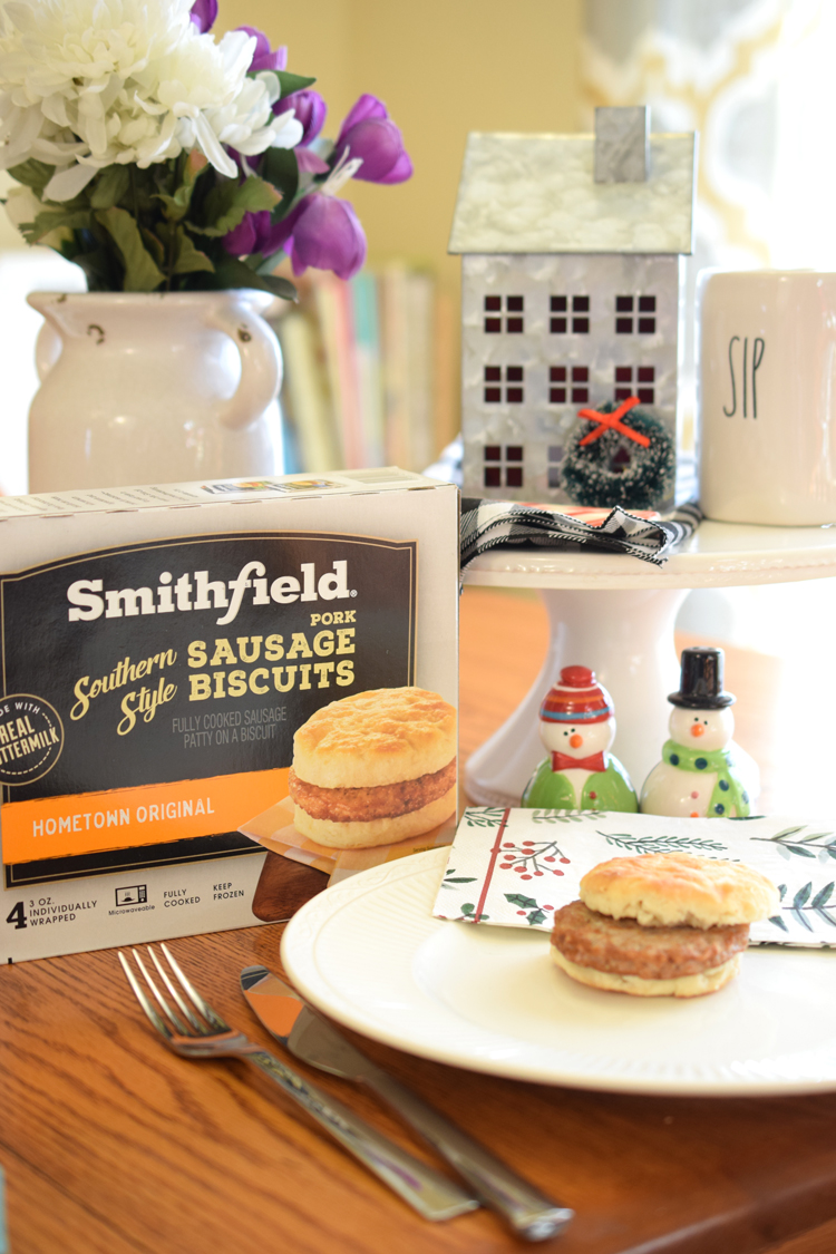 Breakfast table set with flowers, snowmen salt and pepper shakers and Smithfield breakfast sandwiches