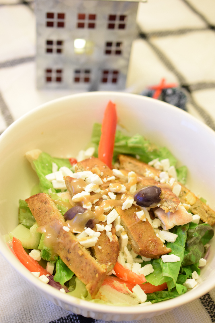 Serve your family and delicious vegetarian meal by making this delicious green salad with Morningstar Falafel Burgers and homemade tahini dressing