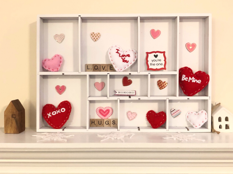A DIY Valentine's Day display. box made from a spray painted drawer organizer