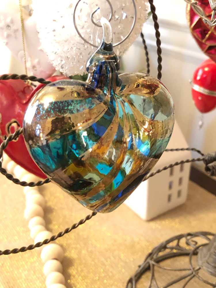 A glass heart ornament on a Valentine's Day ornament tree