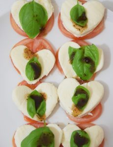Caprese salad with mozzarella, tomato, basil and balsamic vinegar for Valentine's Day