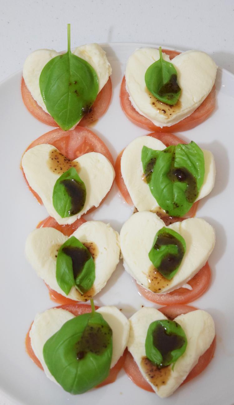 Caprese salad with mozzarella, tomato, basil and balsamic vinegar for Valentine's Day