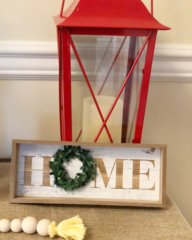 beaded garland, sweet home sign and a red lantern