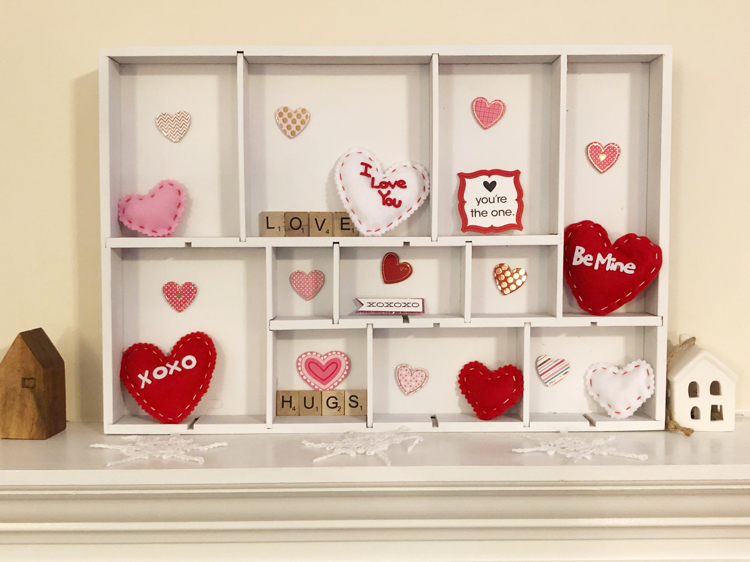A DIY Valentine's Day display box made from a spray painted drawer organizer