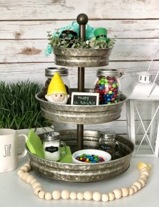 I love how this galvanized metal tray is decorated for St. Patrick's Day with mason jars of Skittles and M&Ms and a cute ceramic leprechaun