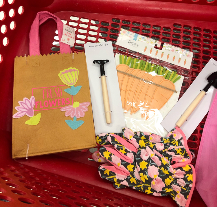 I used these Target dollar spot supplies to make a cute spring gardening wreath.