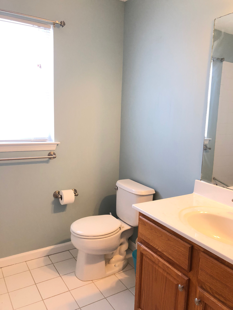 A bathroom painted in Benjamin Moore's Yarrsmouth Blue