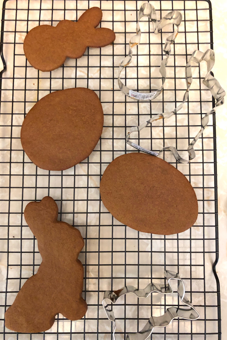 Cooling Easter gingerbread cookies on wire cooling racks