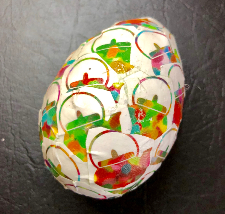 A craft Easter egg decoupaged with origami paper and Mod Podge