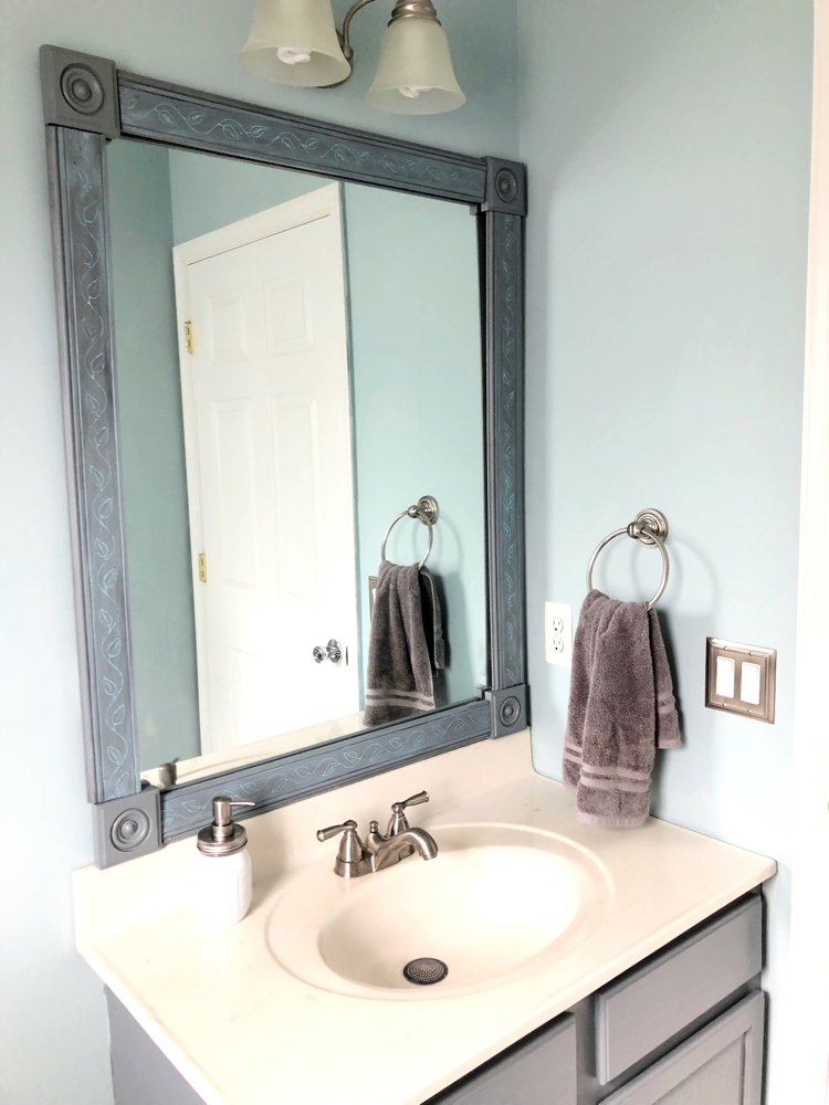 How to make an easy DIY frame for a builder grade bathroom mirror