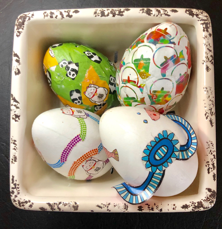 It's fun to decorate craft Easter eggs with Mod Podge and origami paper.