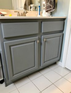 I love how this oak bathroom cabinet was painted in Satin Enamels Smoke Grey paint by Americana Decor.