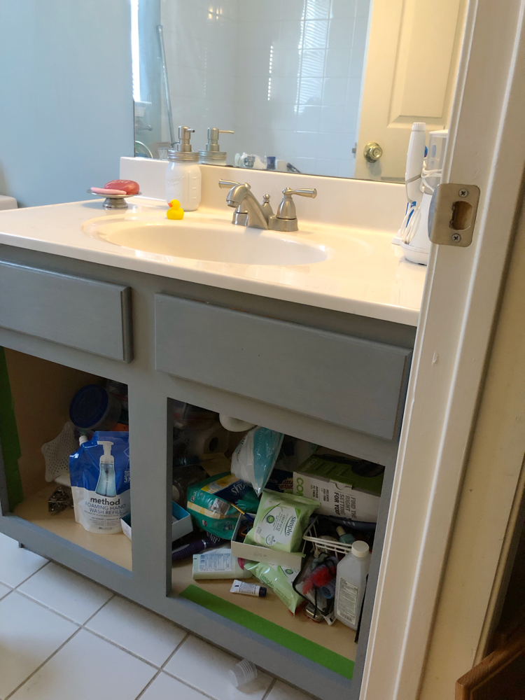 This tutorial shows how easy it is to give an oak bathroom cabinet / vanity a new look with Satin Enamels paint from Americana Decor.