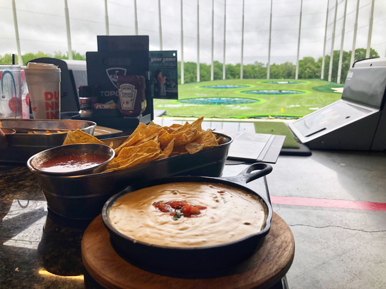 Delicious beer flavored queso and chips at Topgolf in Mount Laurel, NJ
