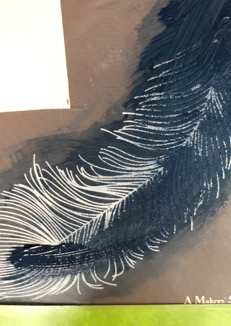 blue paint on a feather stencil