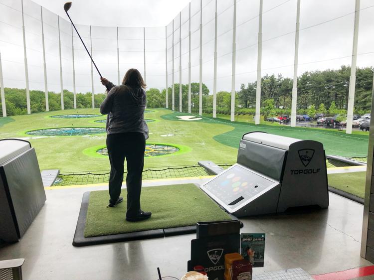 Lauren of Mom Home Guide golfing at Topgolf in Mount Laurel, NJ