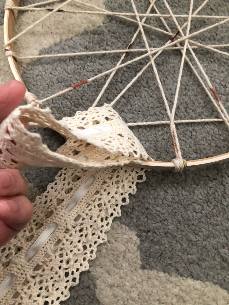tying lace onto a DIY dream catcher
