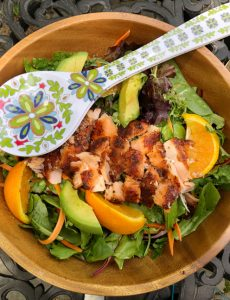 I love this orange and ginger green salad with smoky salmon cooked on a cedar plank