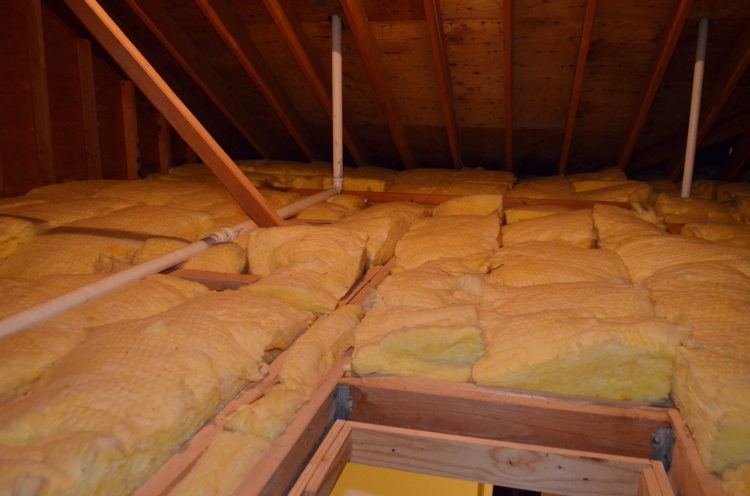 My home's attic before my husband put in easy to install Attic Dek flooring