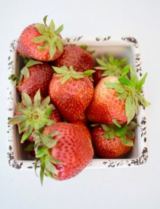 Fresh summer strawberries in a ceramic basket