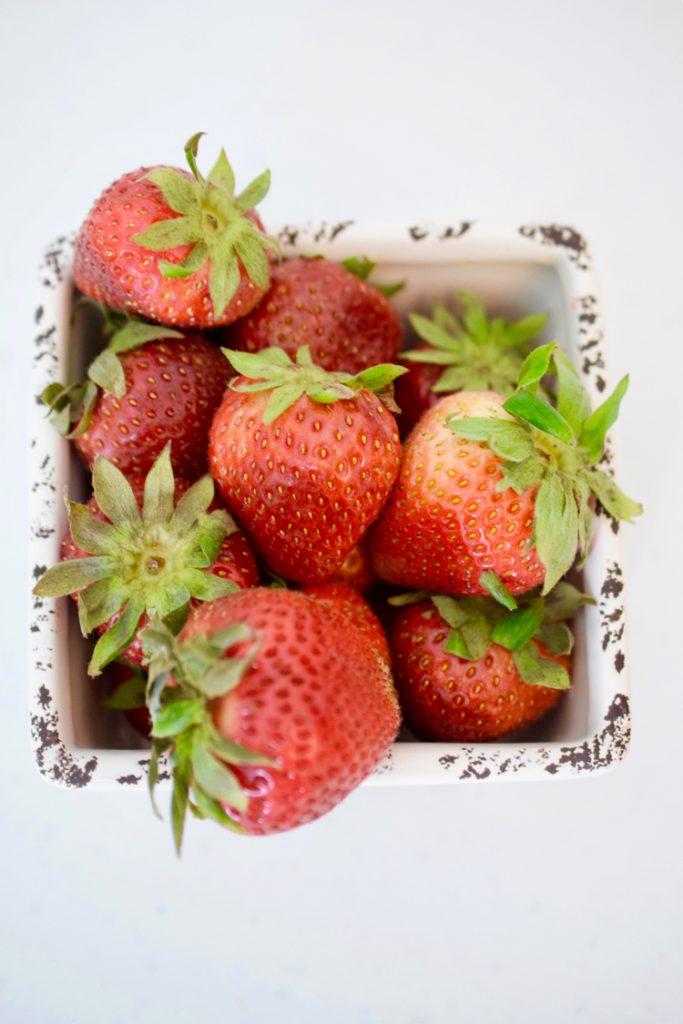 Fresh summer strawberries in a ceramic basket