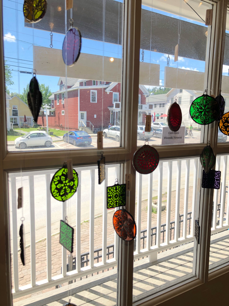 Decorative stained glass hangings in a Stowe, Vermont, crafts store
