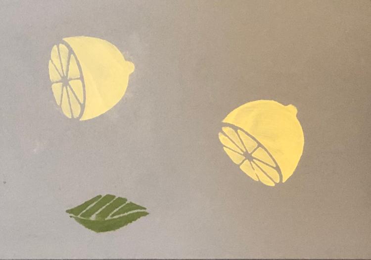 closeup of lemon stenciled table runner