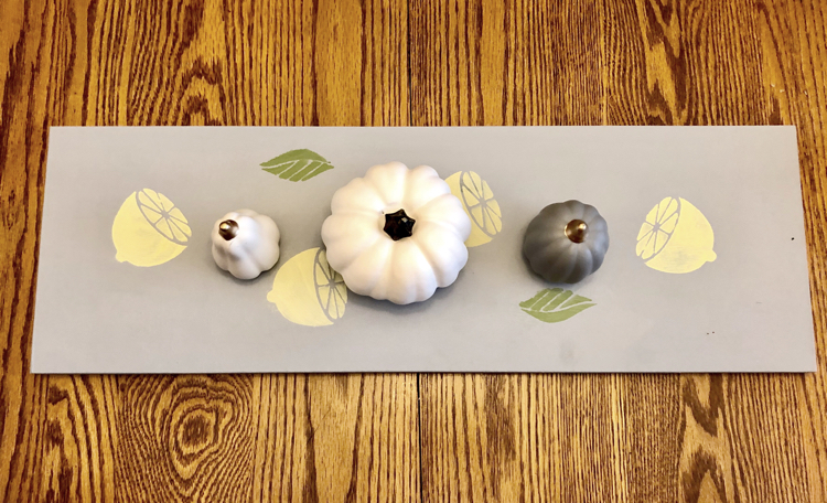 A DIY stenciled wooden table runner using a lemon stencil from DecoArt and Americana Decor Chalky Finish Paints.