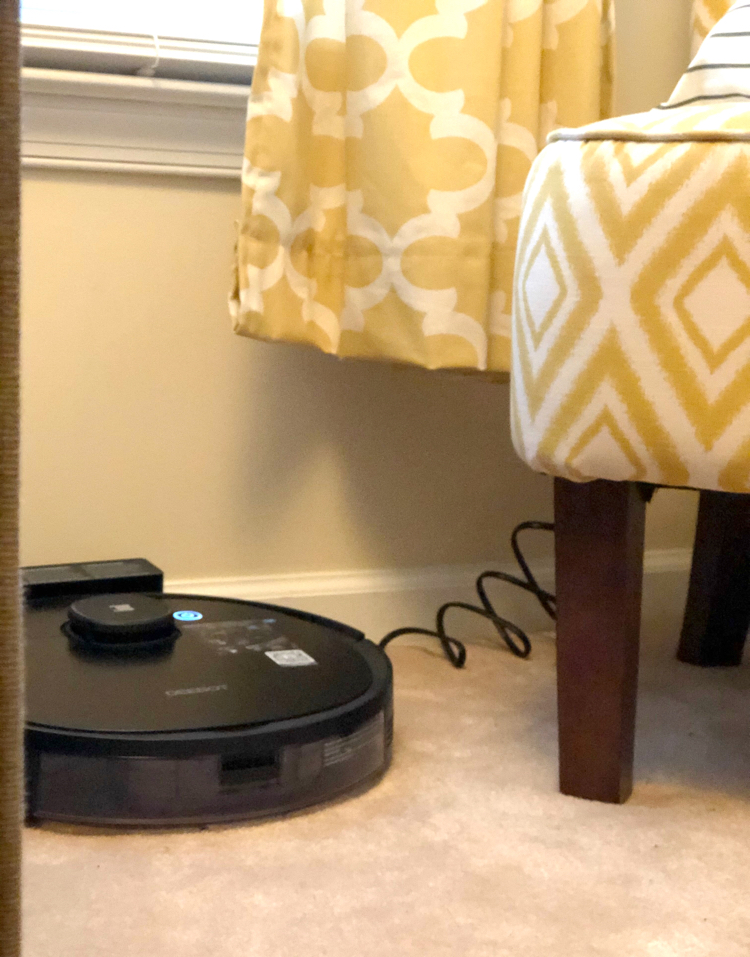 The charging port for the Ecovacs Deebot Ozmo 950 robotic vacuum allows for easy charging between cleanings.