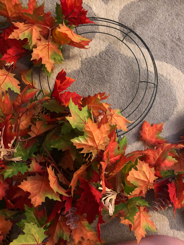 Some fall garlands and a metal wreath form are all that's needed to make a beautiful and easy fall wreath.