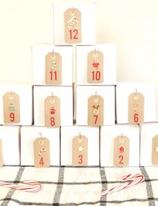 A cute and simple Christmas advent calendar made out of inexpensive gift boxes.