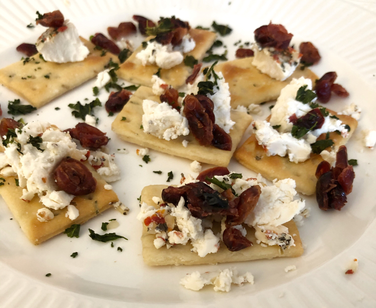 These simple basil and cranberry goat cheese appetizers are perfect for Thanksgiving!