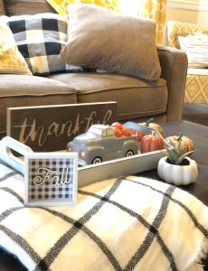A coffee table decorated for Thanksgiving with items from Target and Oriental Trading