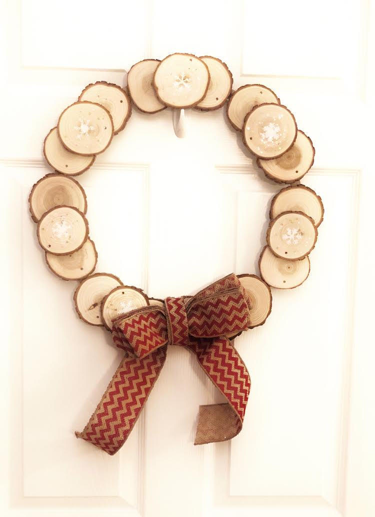 Rustic stenciled wood slice wreath