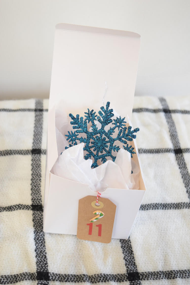 How to create a cute DIY Advent calendar out of gift boxes. Plus, advent calendar filler ideas.