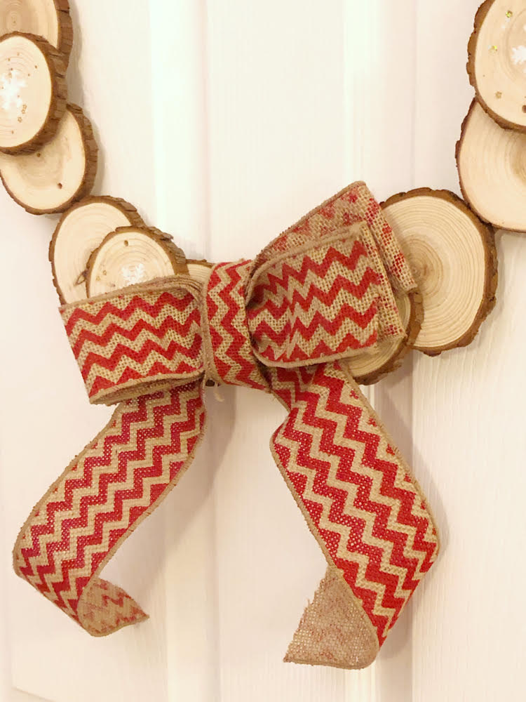 A handmade burlap bow for a DIY wood slice wreath