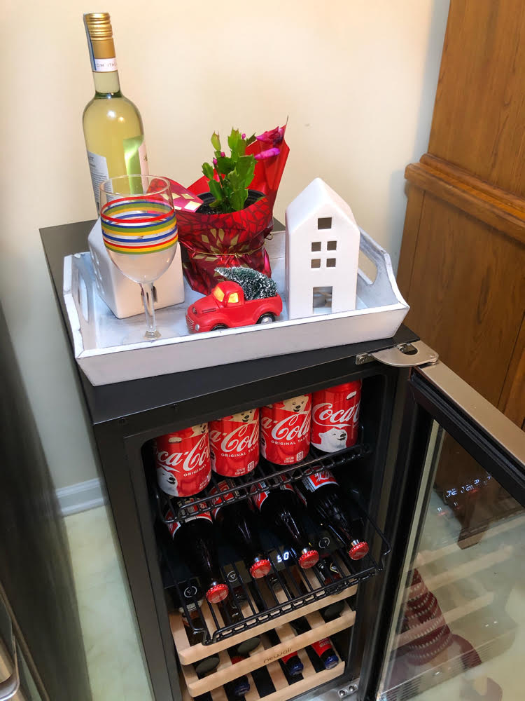 This NewAir wine and beverage fridge makes Christmas entertaining. Plus, use our coupon code to get 20% off!