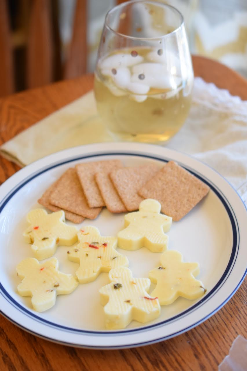 A platter of Cabot pepper jack cheese and crackers for Christmas. I used gingerbread men cookie cutters to cut the cheese.