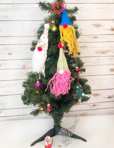 How to make DIY gnome wood slice ornaments for your Christmas tree.