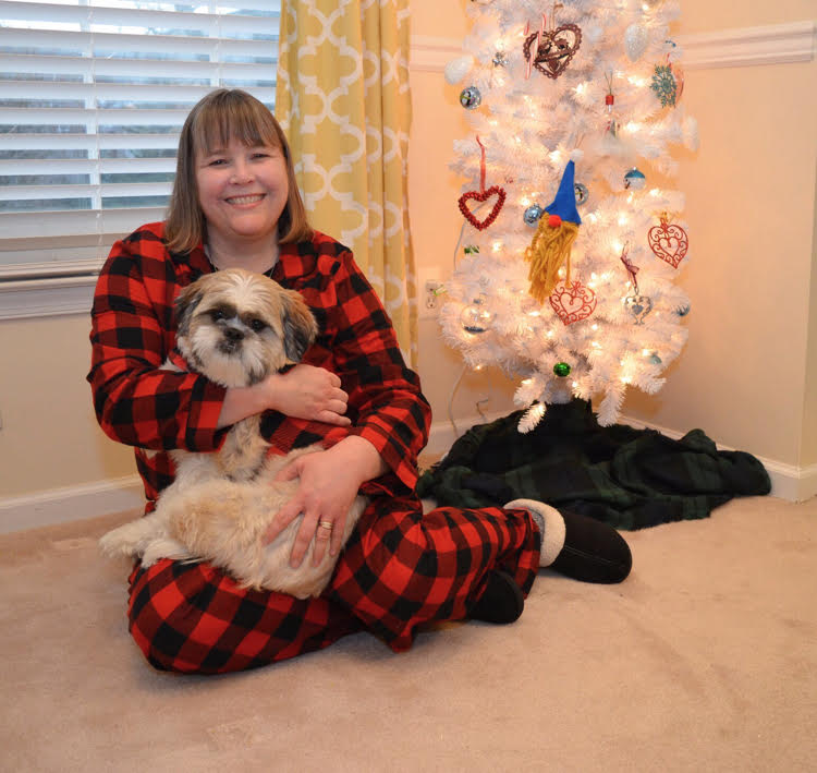 Blogger Lauren Kim with her Shih Tzu puppy and her gnome decorated Christmas tree