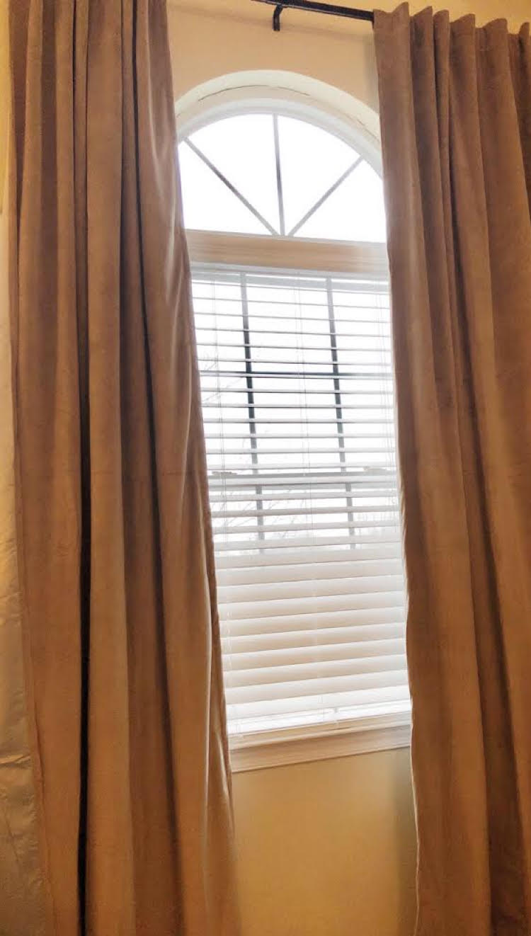 The velvet Therapedic® Carlisle 100% Blackout Rod Pocket Window Curtain Panels are beautiful and blissfully darken a bedroom for sleep. (Available at Bed, Bath & Beyond)