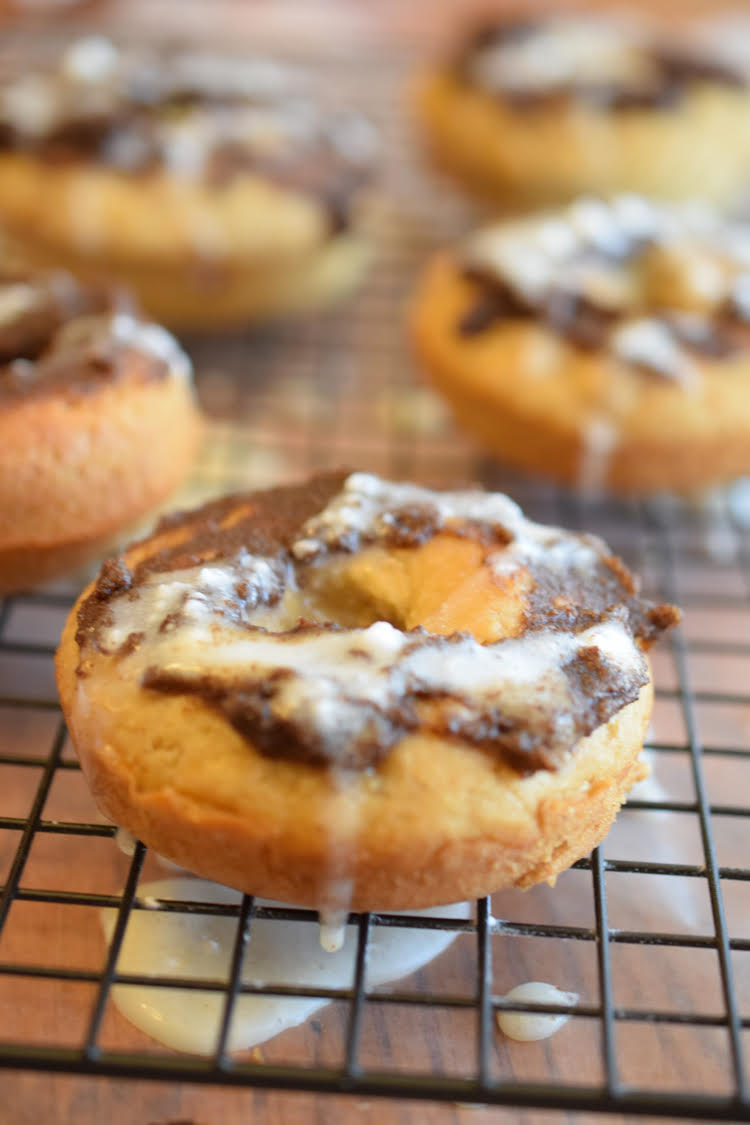 This quick and easy recipe for cinnamon roll donuts is perfect for Christmas morning and the holidays.