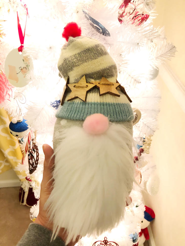 A cute sock gnome made with socks -- these gnomes are no sew and can be made in minutes!