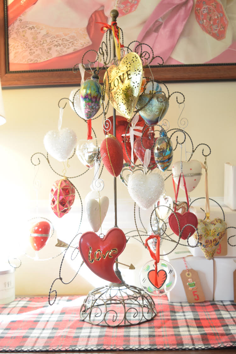 My husband gives me heart ornaments every year. Most of them are on this ornament tree. Sometimes I keep it up all year! Plus, stop by the blog t o see several of my blogging friends' Christmas trees!