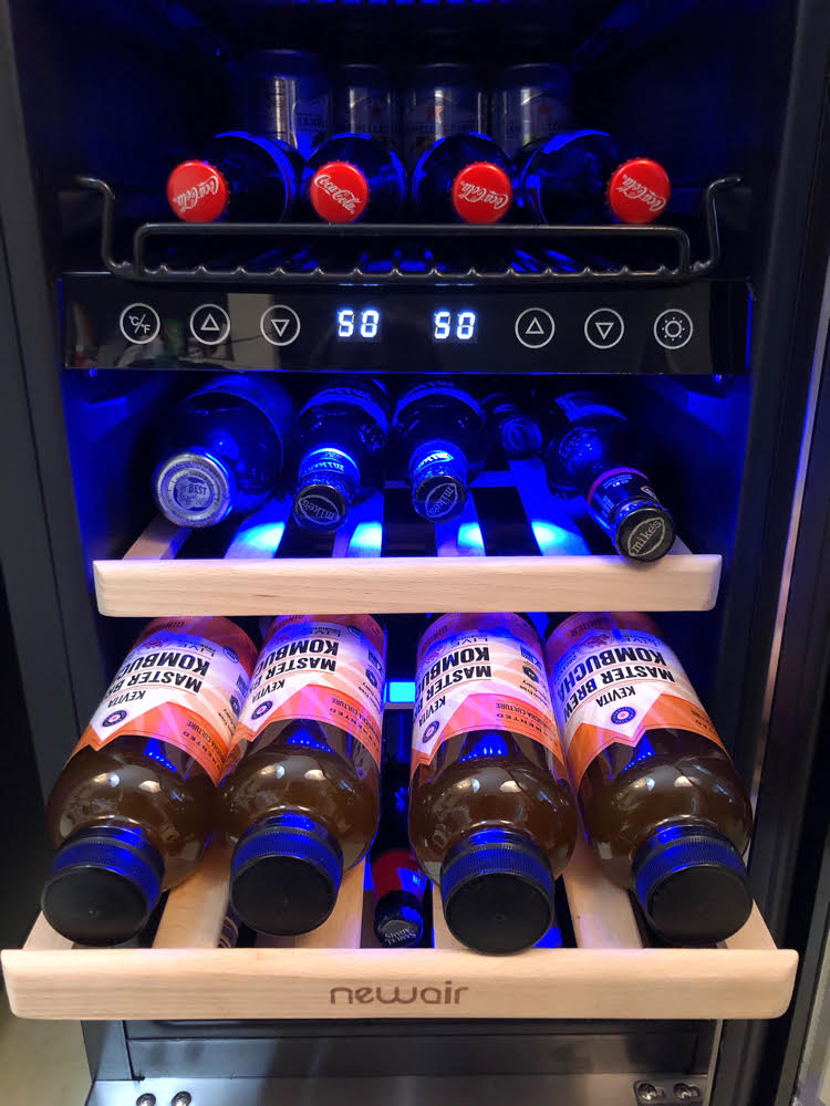 Kombucha in a sleek wine/beverage fridge by NewAir