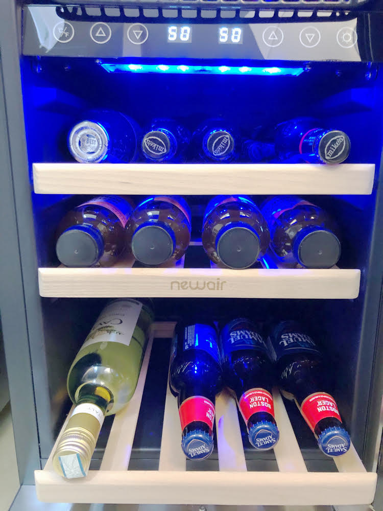 With its wood wine racks, the NewAir wine/beverage cooler has plenty of room for several bottles of wine.