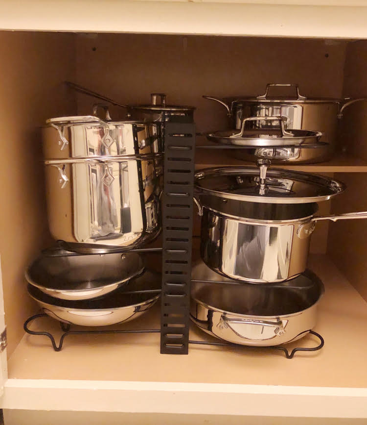 how to organize the D5 All-Clad stainless steel pots and pans set in a cabinet